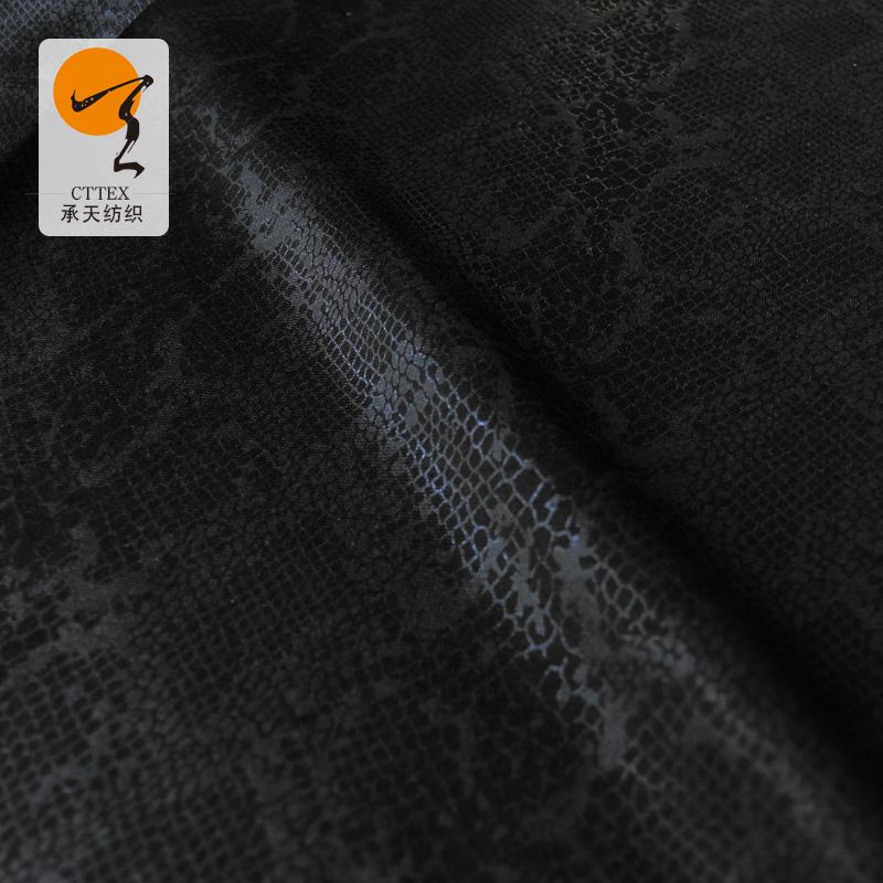 厂家直销NR罗马布烫金 服装纬编烫金面料 粘锦罗马布烫金批发