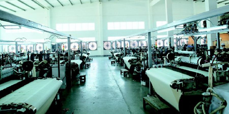 化纤厂车间安装土禾风机水帘通风降温案例-广东新会美达锦纶股份有限公司