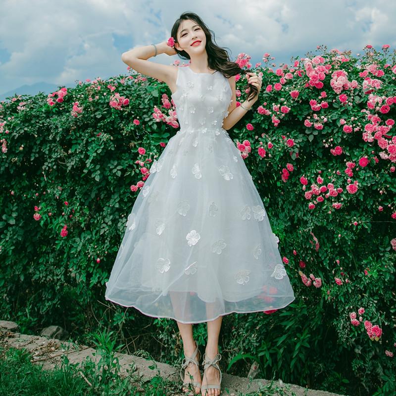 新款欧根纱无袖连衣裙绣花显瘦甜美欧根纱无袖连衣裙修身中长款绣花显瘦根纱无袖连衣裙